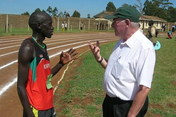 John Kemboi with his coach Colm O'Connell after winning the 5000m at the national high schools championships in Eldoret, Kenya. (David Macharia)