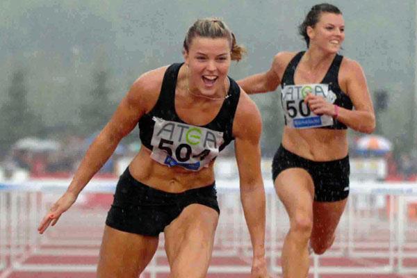 Fun in the rain! Susanna Kallur taking the Swedish title (Hasse Sjogren)