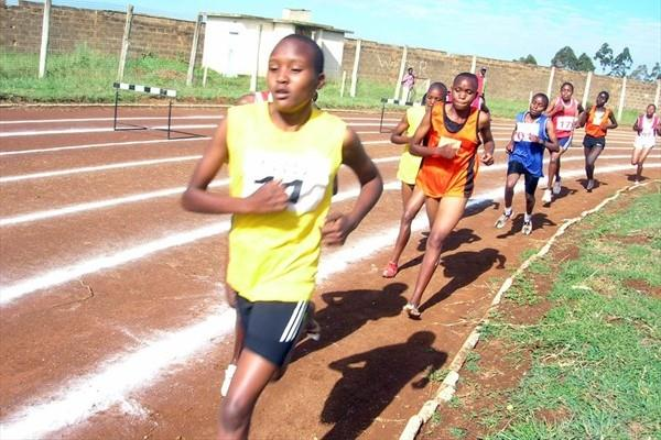 Nelly Chebet (in yellow) leads the 5000m at the Kenyan national high schools championships in Eldoret. She won in 16:30.7 (David Macharia)