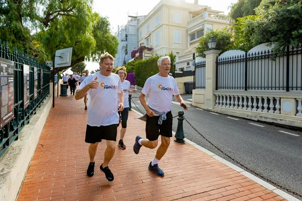 Driving legend Mika Hakkinen running with IAAF Council Membes Sylvia Barlag and Antti Pihlakoski (Robert Palomba)