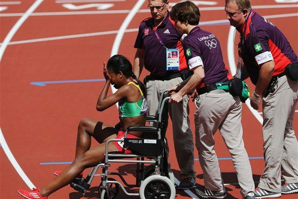 Genzebe Dibaba of Ethiopia is taken off the track in a wheelchair after she competes in the Women's 1500m heat on Day 10 of the London 2012 Olympic Games on 06 August 2012 (Getty Images)