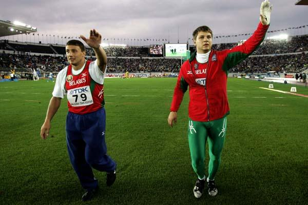 Ivan Tikhon and Vadim Devyatovskiy celebrate after winning gold and silver in the men's Hammer Throw (Getty Images)