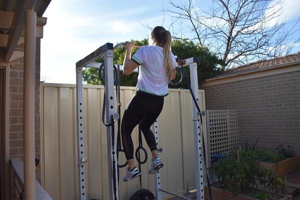 Backyard pull-ups: Kelsey-Lee Barber in her garden gym (Mike Barber)