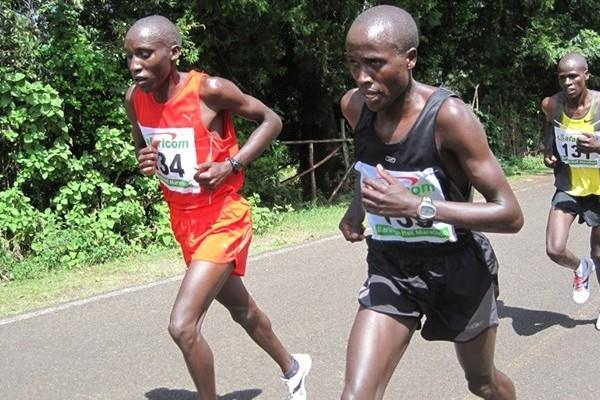 Robert Kipkorir (l) and Augustine Rono battle it out in the final stages of this year's Bringo Half Marathon. Kipkorir won in 1:02:25. (David Macharia)