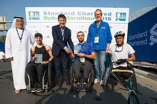 IAAF President Sebastian Coe and IAAF Council member Ahmad Al Kamali (left) with the top three finishers from the Dubai Marathon wheelchair race (L-R): Rob Smith, John Smith and Ali Abdullah Sawalmeh (Organisers)