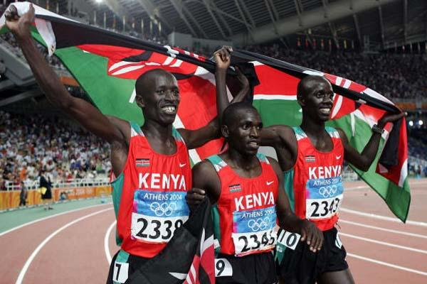 Ezekiel Kemboy, Brimin Kipruto and Paul Kipsiele Koech celebrate sweeping the 3000m Steeplechase for Kenya (Getty Images)