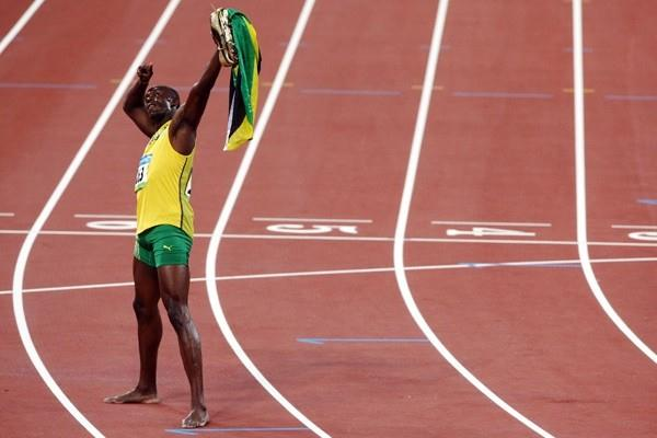 Usain Bolt celebrates his Olympic title and world record (Getty Images)