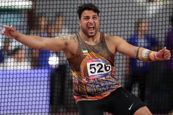 Ehsan Hadadi spins to his sixth Asian title in Doha (AFP/Getty Images)