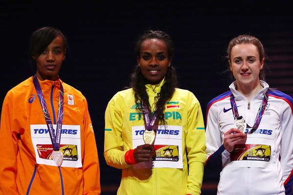 Women's 3000m medallists: winner Genzebe Dibaba (c), silver medallist Sifan Hassan (l) and bronze medallist Laura Muir (r) at the IAAF World Indoor Championships Birmingham 2018 (Getty Images)