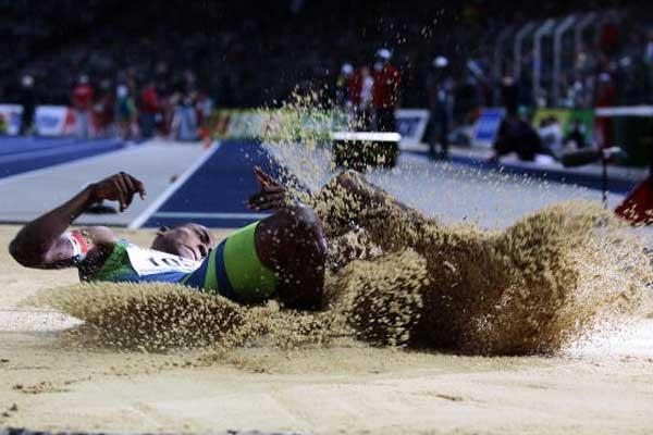Jackpot winner Irving Saladino of Panama in the long jump pit (AFP / Getty Images)