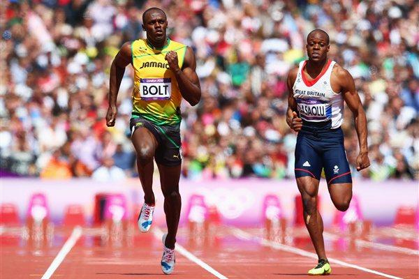 Usain Bolt of Jamaica and James Dasaolu of Great Britain compete in the Men's 100m Round 1 Heats on Day 8 of the London 2012 Olympic Games at Olympic Stadium on August 4 2012 (Getty Images)