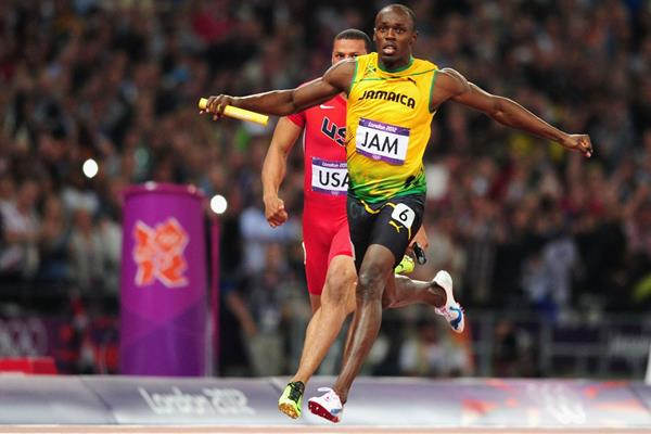 Usain Bolt of Jamaica crosses the finish line ahead of  Ryan Bailey of the United States in the Men's 4 x 100m Relay Final of the London 2012 Olympic Games  on August 11, 2012  (Getty Images)