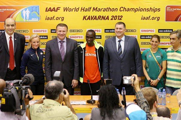 IAAF/LOC press conference in Kavarna, from left: Essar Gabriel, IAAF General Secretary; Shalane Flanagan (USA); Sergey Bubka, IAAF Vice President; Eliud Kipchoge (KEN); Dobromir Karamarinov, President of Bulgarian Athletics Federation and President of LOC; Silviya Danekova (BUL); and Tsonko Tsonev, Mayor of Kavarna Municipality and Vice President of LOC. (Getty Images)