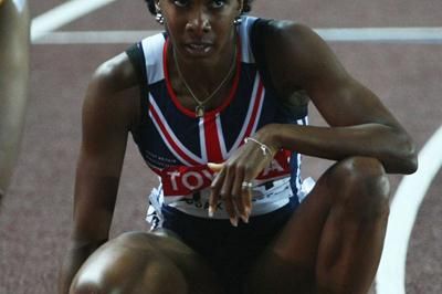 Tasha Danvers-Smith of GBR rests after competing in the Women's 400m Hurdles Final (Bongarts/Getty Images)