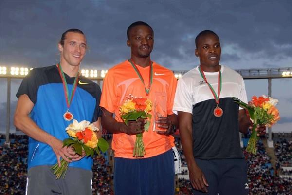 The men's 400m podium in Rabat: runner-up Cedric van Branteghem (BEL), winner Gary Kikaya (COD), and Talkmore Nyongani (ZIM) (organisers)