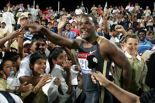 Gatlin is swamped by fans in Doha as he celebrates his World record (AFP / Getty Images)