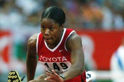 Perdita Felicien wins her 100m Hurdles semi final at the 2003 IAAF World Championships (Getty Images)