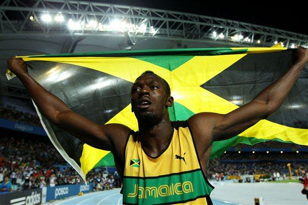 Usain Bolt of Jamaica celebrates claiming gold in the men's 200 metres final (Getty Images)