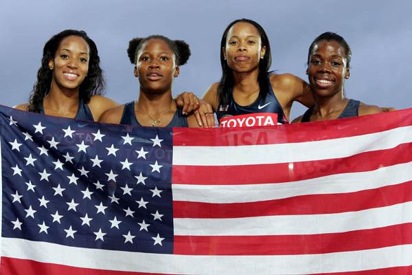 Me'Lisa Barber, Lauryn Williams, Muna Lee and Angela Daigle celebrate winning gold in the 4x100m (Getty Images)