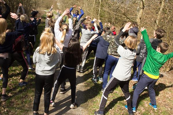 Students from the Aby Skole school in Aarhus, Denmark participate in a cross country workshop with five-time world cross country champion Paul Tergat (Bob Ramsak)