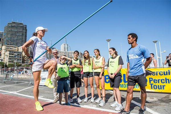 Yelena Isinbayeva shows the good posture during the IAAF/Nestlé Kids' Athletics in Monaco leading up to the Herculis meeting (Philippe Fitte)