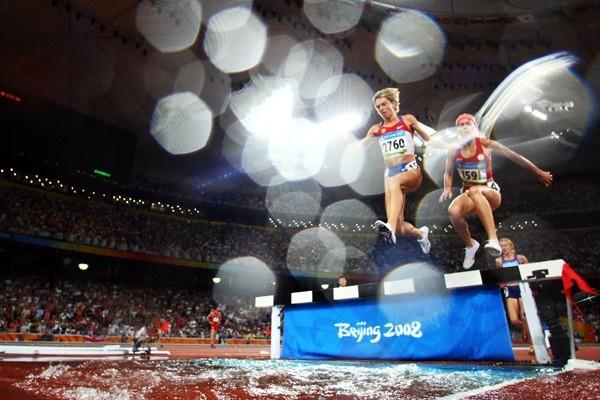 Yekaterina Volkova and Marta Dominguez leap over the water jump in the women's 3000m steeplechase final (Getty Images)