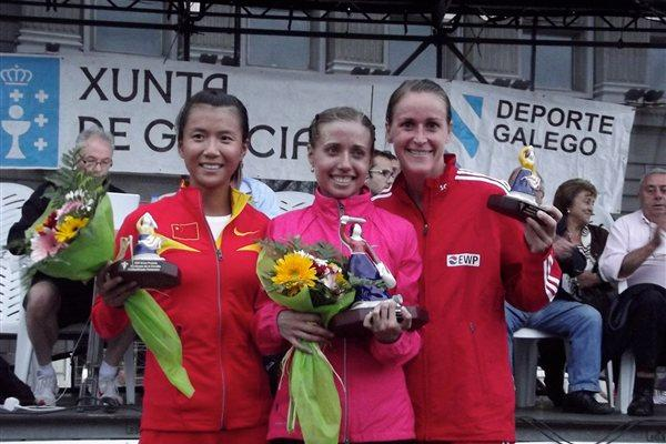The La Coruna 2011 podium trio, from left: runner-up Hong Liu, winner Olga Kaniskina, and third place finisher Melanie Seeger (Véronique Warburton)