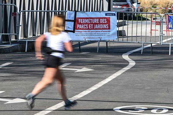 A lone jogger in Paris (AFP/Getty Images)