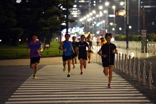 Running around Tokyo's Imperial Palace Gardens at night (AFP / Getty Images)