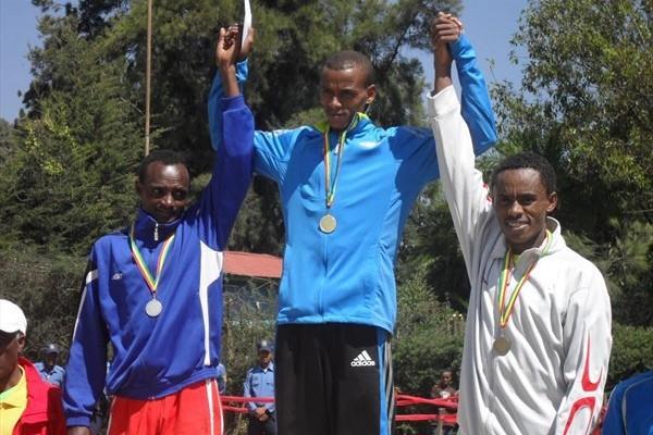 Men's podium at the Ethiopian XC Clubs Champs: Mesfin Haile, winner Bekana Daba and Feysa Lelisa (Bizuayehu Wagaw)