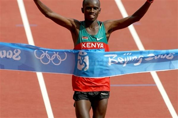 Samuel Wanjiru crosses the line in an Olympic record of 2:06:32 after leading the marathon for most of the way (Getty Images)