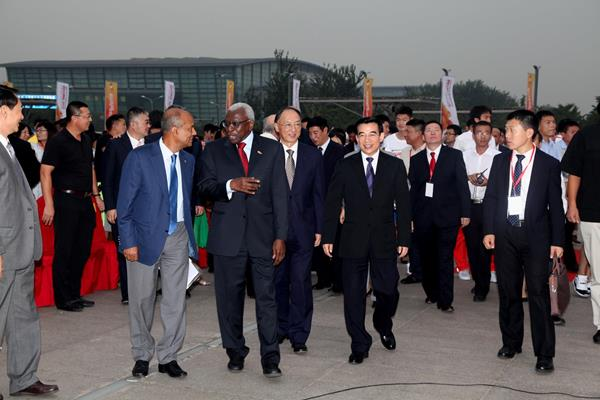 IAAF President Diack with Beijing dignatories and officials, including Mayor of Beijing Wang Anshun (centre, immediately behind President Diack) (IAAF / LOC)