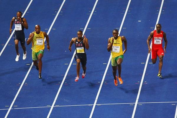 Usain Bolt storming towards another World Record of 9.58 seconds in the men's 100m Final with the USA's Tyson Gay in second and Jamaica's Asafa Powell in third (Getty Images)