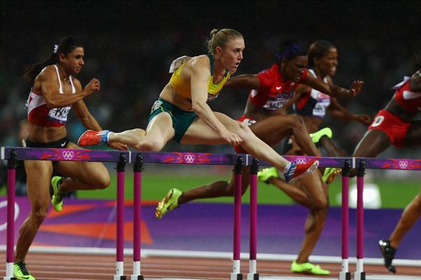 Sally Pearson of Australia leads Nevin Yanit of Turkey and Kellie Wells of the United States during the Women's 100m Hurdles Final on Day 11 of the London 2012 Olympic Games on 7 August 2012 (Getty Images)