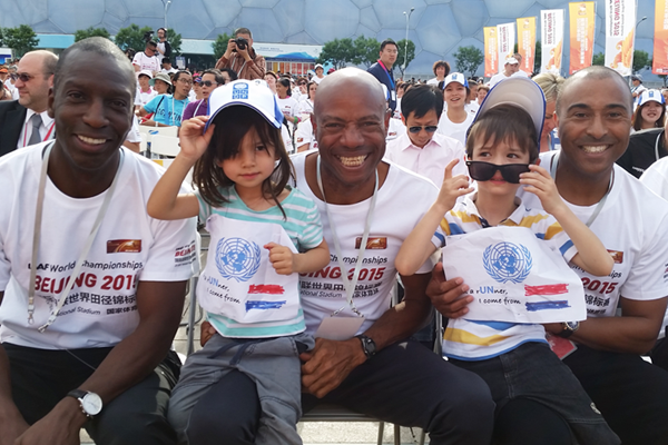 Michael Johnson, Mike Powell and Colin Jackson with local school children at the 100-day countdown ceremony (IAAF)