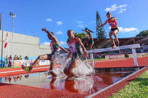 Kenya's Sandra Chebet and Ann Gathoni lead the 2000m steeplechase at the 2015 African Youth Championships (Clyde Koa Wing)