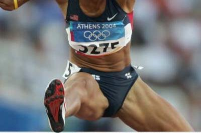 Joanna Hayes of the US sets a new PB in the women's 100m Hurdles semis (Getty Images)