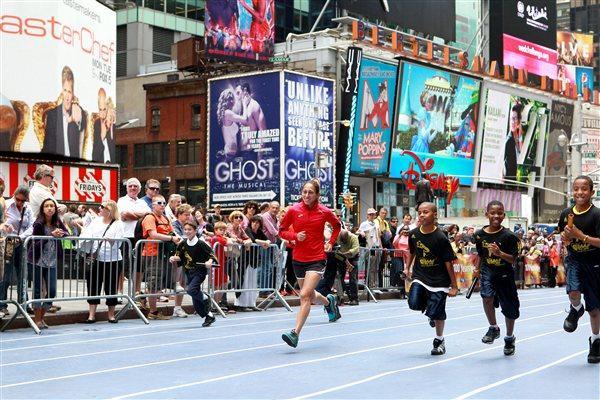 Olympic marathoner Desiree Davila challenged on Times Square (Victah Sailer)
