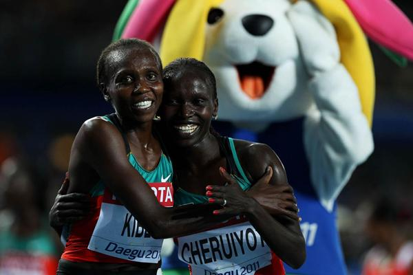Vivian Jepkemoi Cheruiyot of Kenya celebrates winning the women's 5000 metres final with Sylvia Jebiwott Kibet of Kenya  (Getty Images)