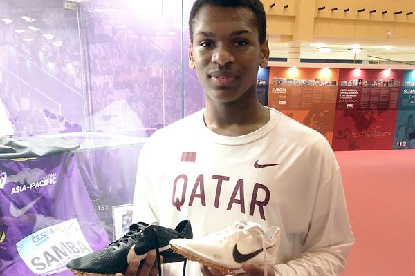 Mubarak Al-Sulaiti with Kevin Mayer's spikes (IAAF Heritage)