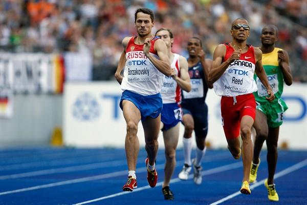 (L-R) Yuriy Borzakovskiy of Russia and Gary Reed of Canada compete in the men's 800m heats at the 12th IAAF World Championships in Athletics (Getty Images)