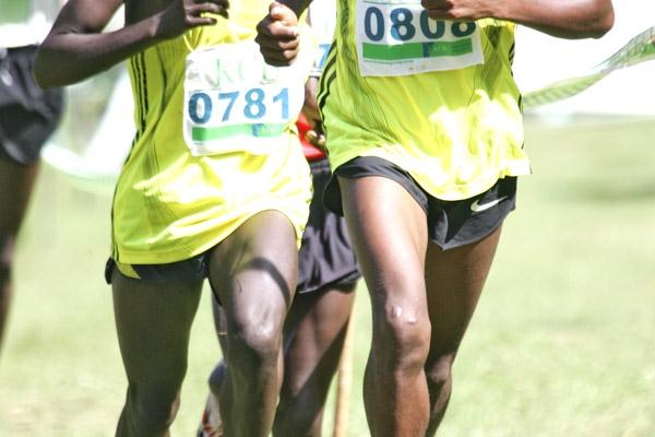 Japheth Korir breaks away from David Silele on his way to winning the 6km junior men's race at the KCB Cross National Country Series at Kisii (Mohammed Amin)