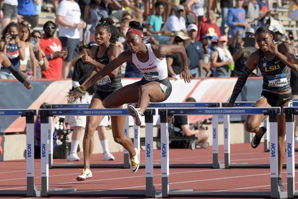 Janeek Brown on her way to winning the 100m hurdles at the NCAA Championships (Kirby Lee)