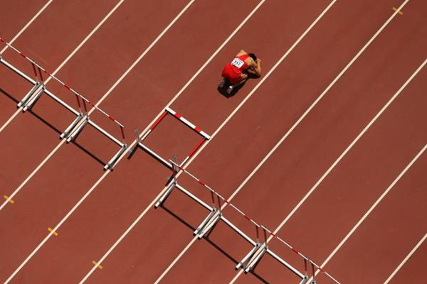 China's Zhang Honglin after falling in his 110m hurdles heat at the IAAF World Championships, Beijing 2015 (Getty Images)