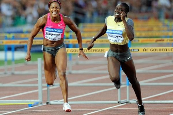 Dawn Harper comes through strong at the end to win the women's 100m hurdles (Getty Images)