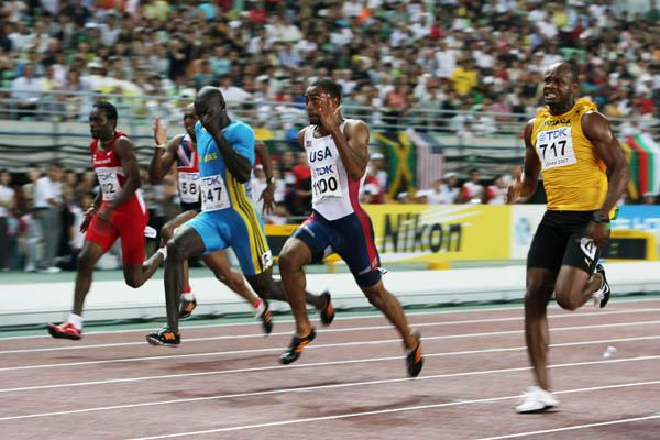 Tyson Gay sprints past Derrick Atkins and Asafa Powell to win the 100m final (Getty Images)