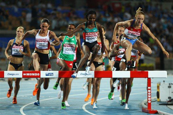 Milcah Chemos Cheywa of Kenya and Yuliya Zaripova of Russia compete in the women's 3000 metre steeplechase during day four (Getty Images)