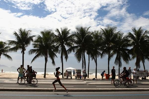 Lornah Kiplagat makes a break along Copacabana beach (Getty Images)