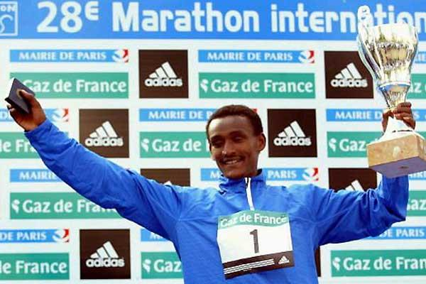 Ambesa Tolosa of Ethiopia celebrates his Paris Marathon win (Getty Images)