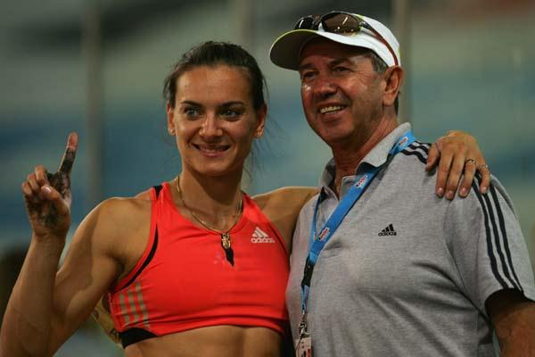 Winner of the IAAF Coaches' Award, Vitaly Petrov with Yelena Isinbayeva (Getty Images)
